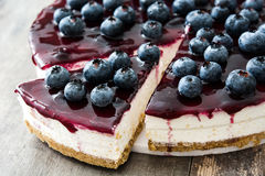Blueberry cheesecake on wood. En table stock photography