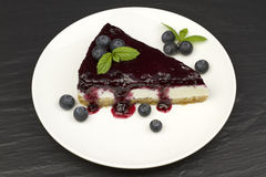 Blueberry cheesecake - ( Manhattan style ) on black stone background. Royalty Free Stock Photo