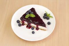Blueberry cheesecake - ( Manhattan style ) on wood background, Stock Photos