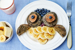 Blueberry chocolate pancake with bananas in the shape of an owl Stock Image