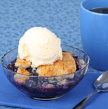 Blueberry Cobbler Dessert. With a scoop of ice cream and cup of coffee stock photo