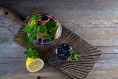 Blueberry Cocktail - Mojito with Fresh Berry Lemon, lime, ice and mint on old wooden background Top view, Stock Images