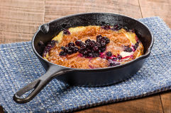 Blueberry croissant breakfast in skillet Stock Photo