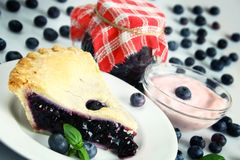Blueberry desserts. Blueberries used in various desserts: pie, jam, preserves and yogurt stock photos