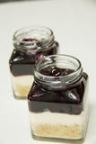 Blueberry filling and creamcheese served in glass. A Blueberry filling and creamcheese served in glass stock photos
