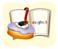 Blueberry flavor doughnut and book Stock Photo