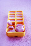 Blueberry-flavored ice cubes Stock Images