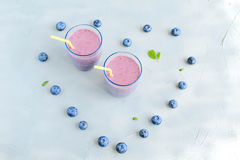 Blueberry Fresh and Cold Smoothie in Glasses Heart shape berries around Royalty Free Stock Photography