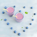 Blueberry Fresh and Cold Smoothie in Glasses Heart shape berries around Stock Photography