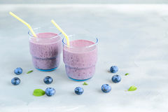 Blueberry Fresh and Cold Smoothie in Glasses Heart shape berries around Stock Photos