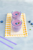 Blueberry Fresh and Cold Smoothie in Glasses Royalty Free Stock Image
