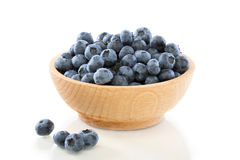 Blueberry fruit in a wooden bowl . Royalty Free Stock Images