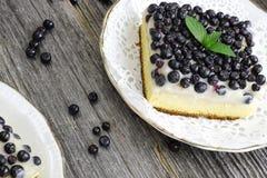 Blueberry fruitcake on wooden background Royalty Free Stock Photos