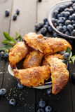 Blueberry hand pies on black wooden table Stock Images