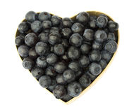 Blueberry heart. Blueberries shaped like a heart. Isolated on white Royalty Free Stock Photo