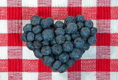 Blueberry heart on checkered background Stock Photo