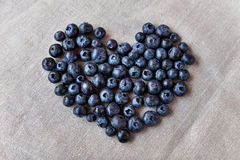 Blueberry heart  lie on a homespun tablecloth. Royalty Free Stock Images