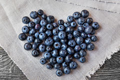 Blueberry heart  lie on a homespun tablecloth Royalty Free Stock Image