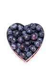 Blueberry heart on white Stock Photos