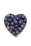 Blueberry heart on white Stock Photos