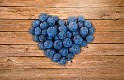 Blueberry heart on wood Royalty Free Stock Photography