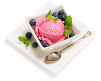 Blueberry ice cream with berry in a bowl. Ice cream dessert with blueberries on a white plate  on white stock photography