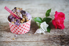 Blueberry ice cream with chocolate and cookie crumble on top Royalty Free Stock Image