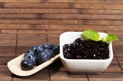 Blueberry jam and blueberries Stock Images