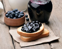 Blueberry jam, bread and fresh berries Stock Images