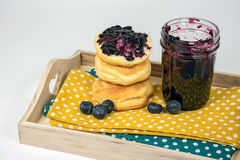 Blueberry jam on bread roll Royalty Free Stock Photography