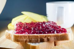 Blueberry jam on brown bread with mango and coffee. Morning breakfast have blueberry jam on brown bread with mango and coffee. It is healthy food and good for Royalty Free Stock Photography