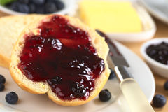Blueberry Jam on Bun Stock Images