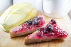 Blueberry jam and currants on triangle bread with mango. Morning breakfast have blueberry jam and currants on brown bread with mango. It is healthy food and Stock Images