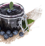 Blueberry Jam isolated on white Stock Photos
