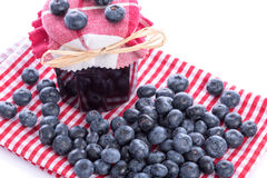 Blueberry jam jar with fresh blueberries. On dish towel Royalty Free Stock Photo