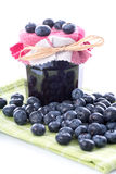 Blueberry jam jar with fresh blueberries Royalty Free Stock Images
