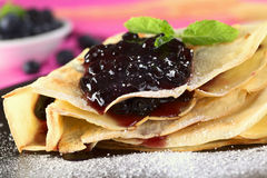 Blueberry Jam on Pancake. Folded pancake filled with blueberry jam and sugar powder on top (Selective Focus, Focus on the front of the jam filling Royalty Free Stock Image