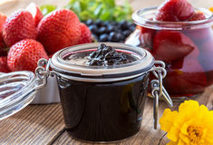 Blueberry jam strawberry jam in glass jar Royalty Free Stock Photo
