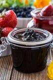 Blueberry jam, strawberry jam in glass jar Stock Photography