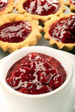 Blueberry jam in white jar and muffins Royalty Free Stock Photo