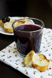Blueberry jelly with ship biscuit. Blueberry jelly in a glass with ship biscuit on a black table view closeup Stock Photo