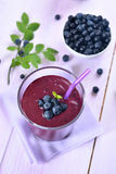 Blueberry juice with fresh berries Royalty Free Stock Photos