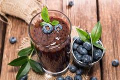Blueberry Juice. With fresh fruits on wood stock photo