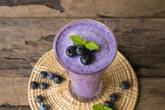 Blueberry smoothiesl fruit juice milkshake blend beverage healthy high protein the taste yummy In glass drink episode. Blueberry smoothie purple colorful fruit royalty free stock image