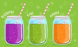 Blueberry kiwi mango smoothies in glass jar. Smoothies in glass jar Blueberry kiwi mango Royalty Free Stock Images