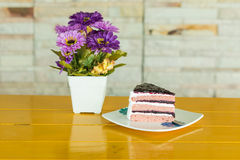 Blueberry layer cake and  Purple artificial flower Stock Photography