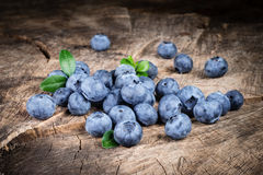 Blueberry with leaves on wood Stock Photo