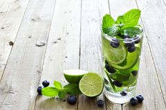 Blueberry, lime, mint detox water against rustic wood Stock Image
