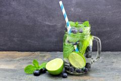 Blueberry, lime, mint detox water in a jar against slate Stock Photography
