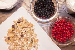 Blueberry, lingonberry and muesli. On a breakfast table Stock Photography